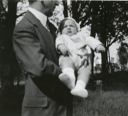 John M. Dever holding his son April 1938.