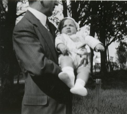John M. Dever holding his son April 1938.