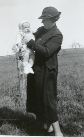 Beatrice holding her son John April 1938.